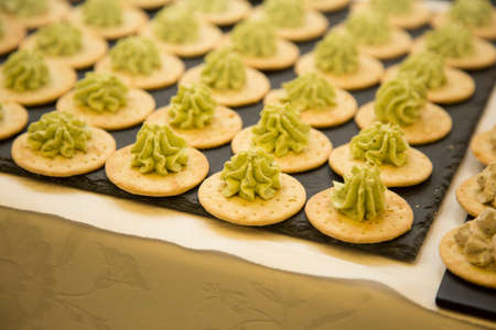horizontal image with detail of open sandwiches with green sauce Banco de Imagens