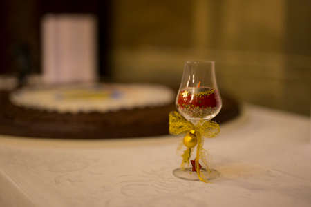 horizontal image with detail of an ornate wine glass for a corporate Christmas party