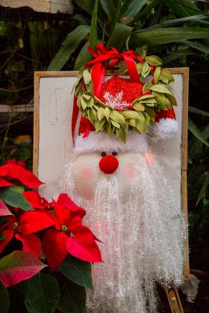 vertical image of a Christmas decoration showing a nice Santa Claus puppet Banco de Imagens