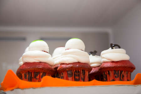 horizontal image with detail of a cake with cream photographed inside a fridge