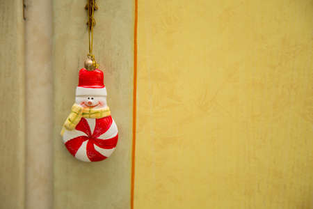 horizontal image with detail of a nice Christmas decoration hanging from a wardrobe key