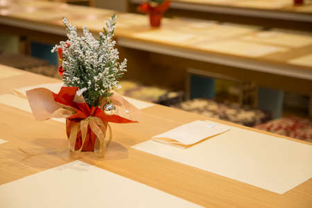 horizontal image with detail of a restaurant table prepared for two, in the evening with Christmas decorations