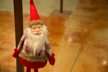 horizontal image with detail of a nice Santa Claus puppet Banco de Imagens