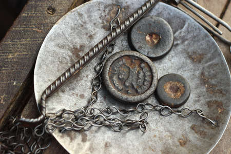 traditional metal scale weights and scale tray at a food market stall in Southeast Asia