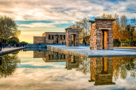 Sunset at the Debod temple in Madrid. Reflection in the water. Stock Photo