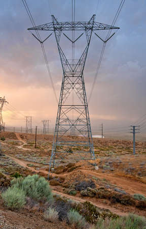 A large power transmission tower and power lines running through the Antelope Valley. photo