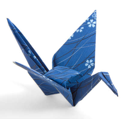 Dark Blue Origami Crane folded with a textured paper photo