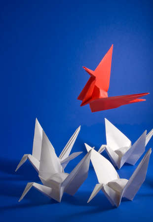 rise above: A red crane rising above the crowd Stock Photo