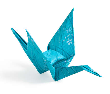 Blue Origami Crane folded with textured paper Banco de Imagens