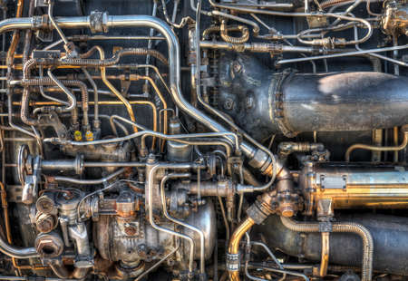 The pipes and mechanical systems of an aircraft jet engine.  Would make a great steam punk background. photo