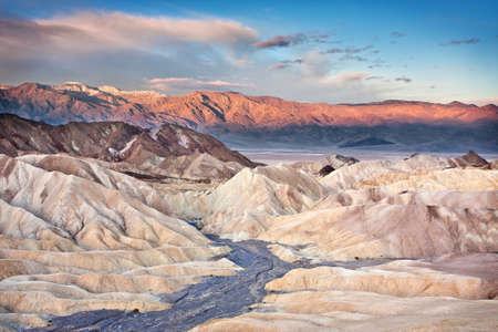 badland: Sunrise taken from Zabriskie Point in Death Valley National Park    Beautiful colors light the mountains in the background  Stock Photo
