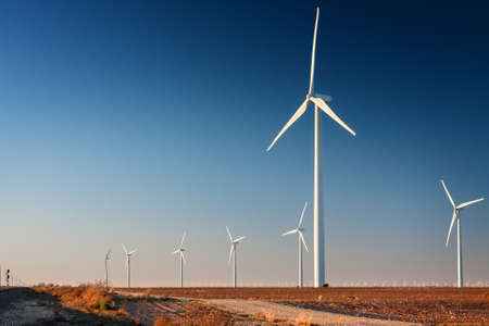 Tall wind turbine in a West Texas cotton field   Part of a larger wind farm