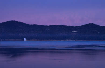frozen lake: Reflection of the Solar Observatory on Big Bear Lake at Sunrise in California