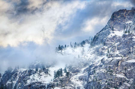 ridgeline: A winter ridgeline with low hanging clouds Stock Photo