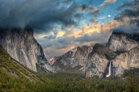 tunnel view: Tunnel View during a clearing storm with the moon rising