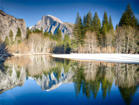 merced: View of half dome reflected in the Merced river at Yosemite National Park