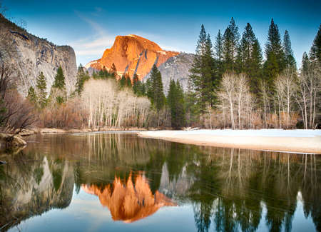 View of half dome at sunset reflected in the Merced River