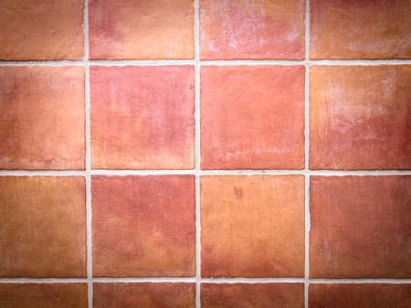 grout: Red stone wall tile with white grout