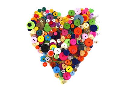 haberdashery: Heart shape made of colourful haberdashery buttons