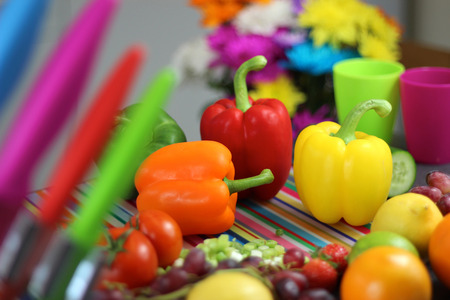 preperation: Colorful food preperation. Peppers, fruit and vegetables on chopping board