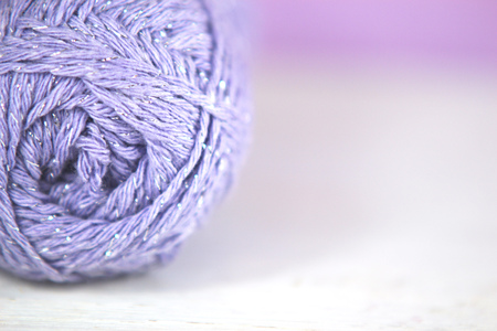 craft background: Lilac yarn  wool Macro on soft focus background. Great craft background with copy space.