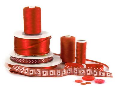 haberdashery: red craft, sewing and haberdashery items on white background Stock Photo