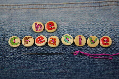 Be Creative spelled out in letterd buttons