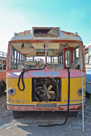 broken down: Colorful, rusted, broken down old bus. Stock Photo
