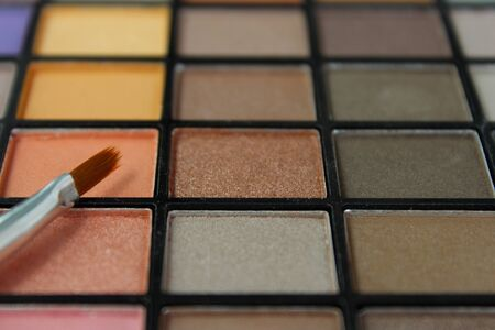 Eyeshadow palette with focus on brush. Stock Photo