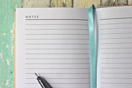 Notes page of diary. Blank page with pen. Stock Photo