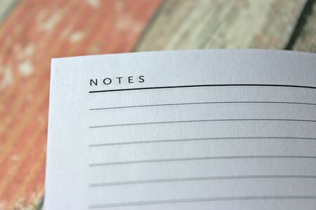 Blank diary 'notes' page against rustic wooden background