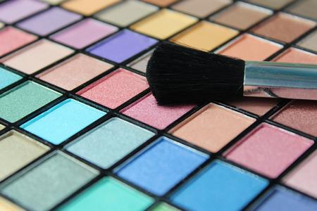 Large make up palette, focus on make up brush.