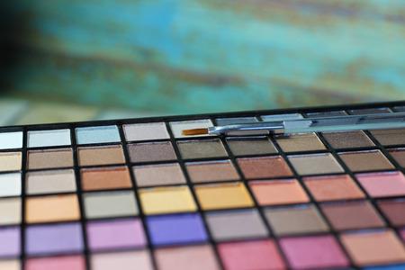 large eyeshadow palette. Focus on makeup brush.