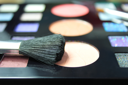 Make up palette and brush. Focus on blusher brush Stock Photo