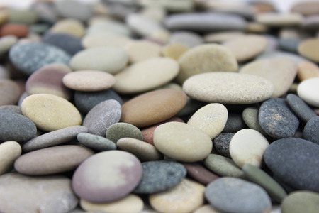 Colored Beach stones or pebbles close up macro shot. Standard-Bild
