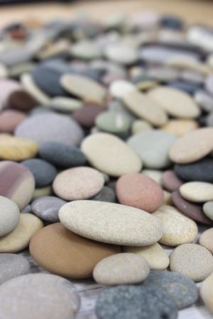 Colorful pebbles on a beach. Portrait.
