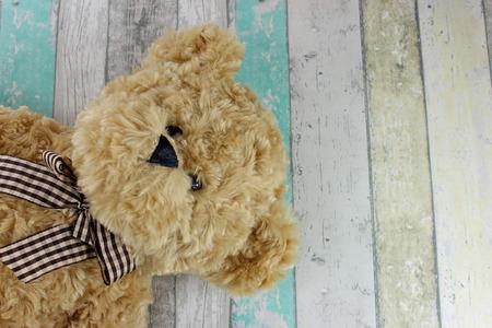 Cute Teddy bear on a distressed wood background.