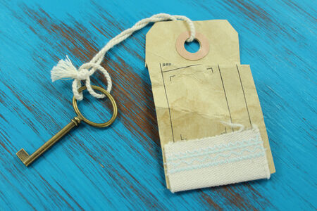 The key to success. Blue rustic wooden background. Keuy and tag with the word success