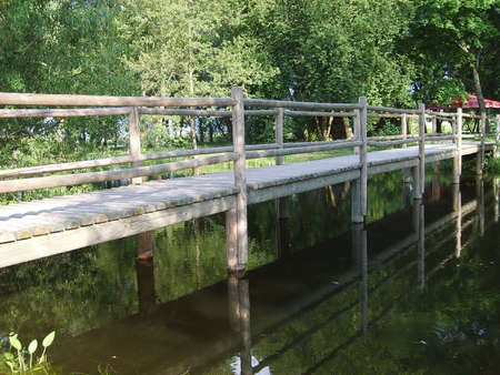 olden: The timbered bridge under olden time through a pond Stock Photo