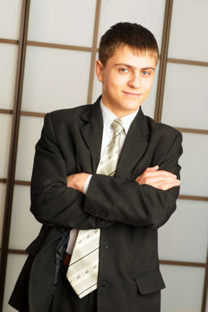 young sure of itself businessman in office