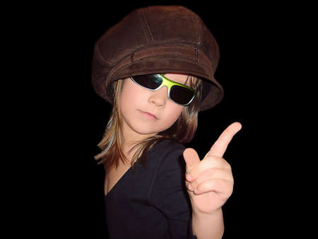 threatens: portrait  girl bespectacled and hat threatens finger Stock Photo