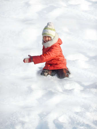 Small girl game of snow Stock Photo