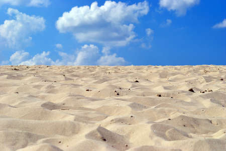 Sea yellow clean sand on background blue sky. Stock Photo
