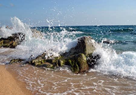 Sea waves are broken about stones on sea coast Stock Photo