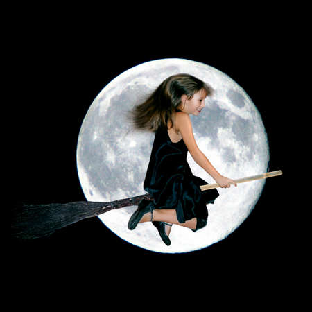 cheerful little witch flying on a broom against the background of the full moon. collage photo