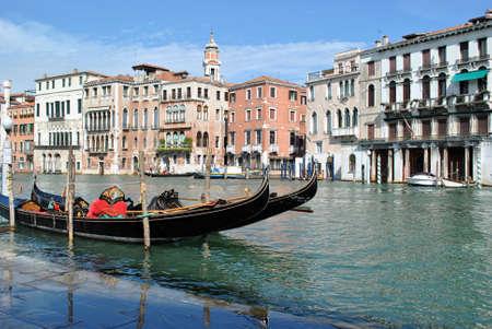 Gondolas on the docks in Grand Canal in Venice photo
