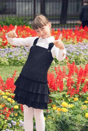 Teen schoolgirl shows gesture - okey Stock Photo