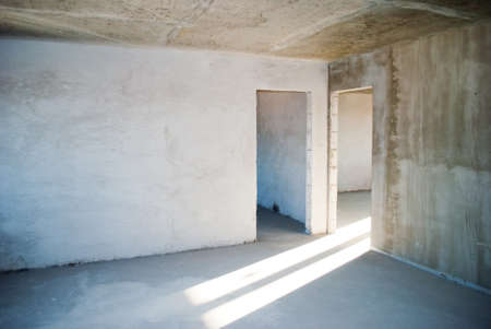 empty concrete gray wall of the apartment before renovation Stock Photo