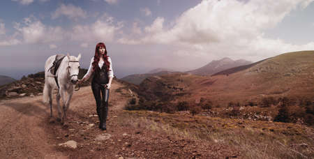 woman with red hair white horse is in mountains