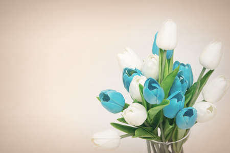 Delicate greeting card with bouquets of tulips in a vase with a blank space for an inscription
